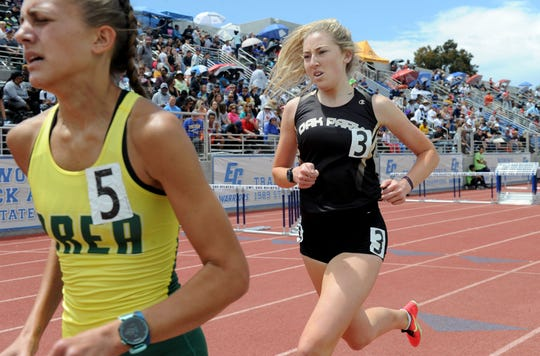 Whitney Valenti, left, of Brea Olinda, left, is in first place during the third lap of the Division 3 1,600-meter run, but Sarah Shulze, center, of Oak Park would go on to win the race at the CIF-SS Track and Field Championships at El Camino College in Torrance on Saturday. Shulze also won the 3,200 title.