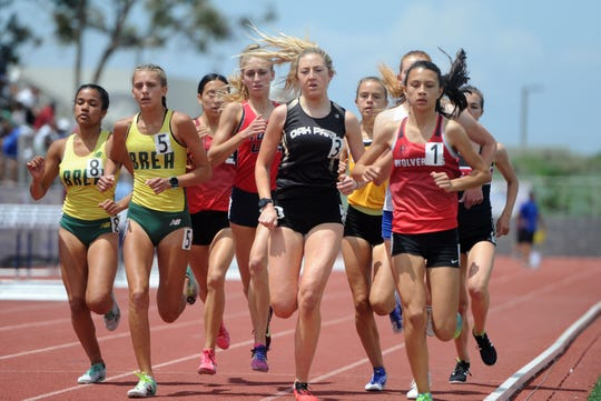 Sarah Shulze, center, of Oak Park runs with the pace in the Division 3 1,600-meter race at the CIF-SS Track and Field Championships at El Camino College in Torrance on Saturday. Shulze won the race and also the 3,200 title.