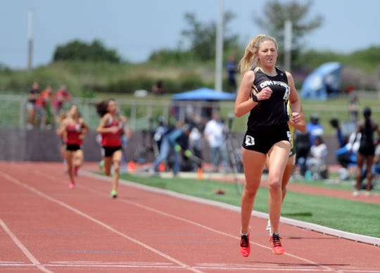 Sarah Shulze of Oak Park is in the lead en route to winning the Division 3 1,600-meter title at the CIF-SS Track and Field Championships at El Camino College in Torrance on Saturday. Shulze won the race in 4 minutes, 54.24 seconds, and later won the 3,200 in 10:38.53.