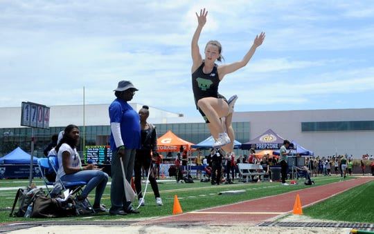 Kimberly Bolt of Thousand Oaks  High flies through the air during the Division 2 long jump competition at the CIF-SS Track and Field Championships at El Camino College in Torrance on Saturday. Bolt finished ninth.