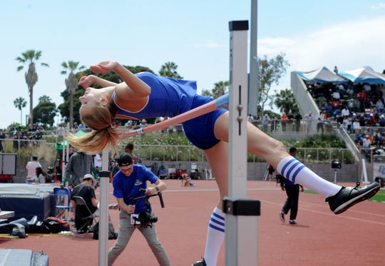 Paige Sommers of Westlake High gets up and over during the Division 2 high jump competition at the CIF-SS Track and Field Championships at El Camino College in Torrance on Saturday. Sommers won the high jump and pole vault titles.