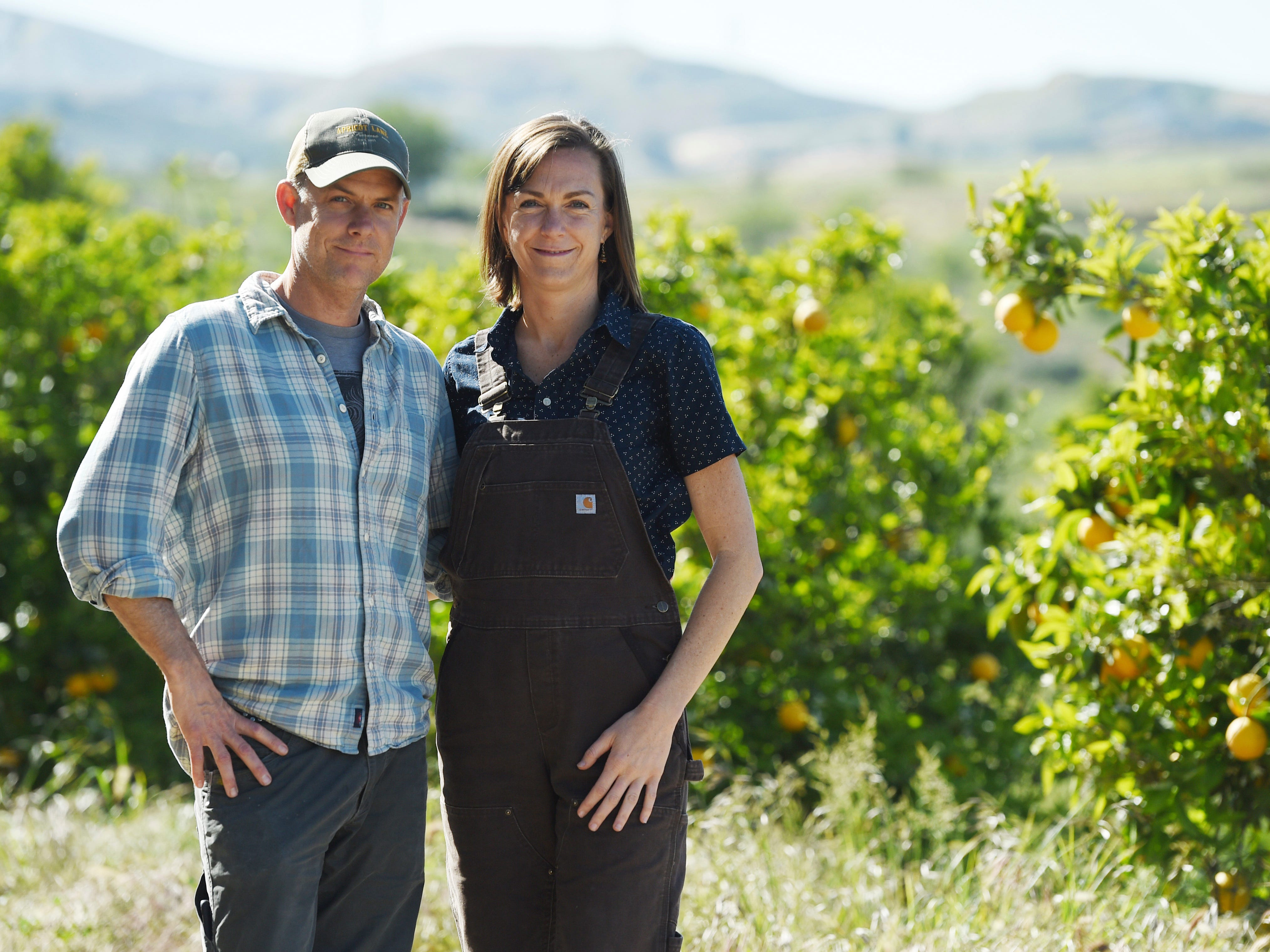 "This April photo shows John Chester, left, and his wife Molly, of the documentary film ""The Biggest Little Farm,"" at Apricot Lane Farms in Moorpark."