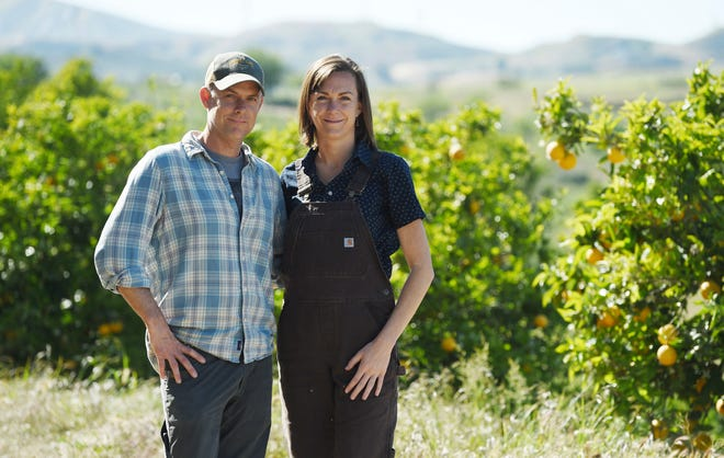 "John Chester and Molly Chester pose in an orchard at Apricot Lane Farms in Moorpark, the setting of their documentary ""The Biggest Little Farm."""