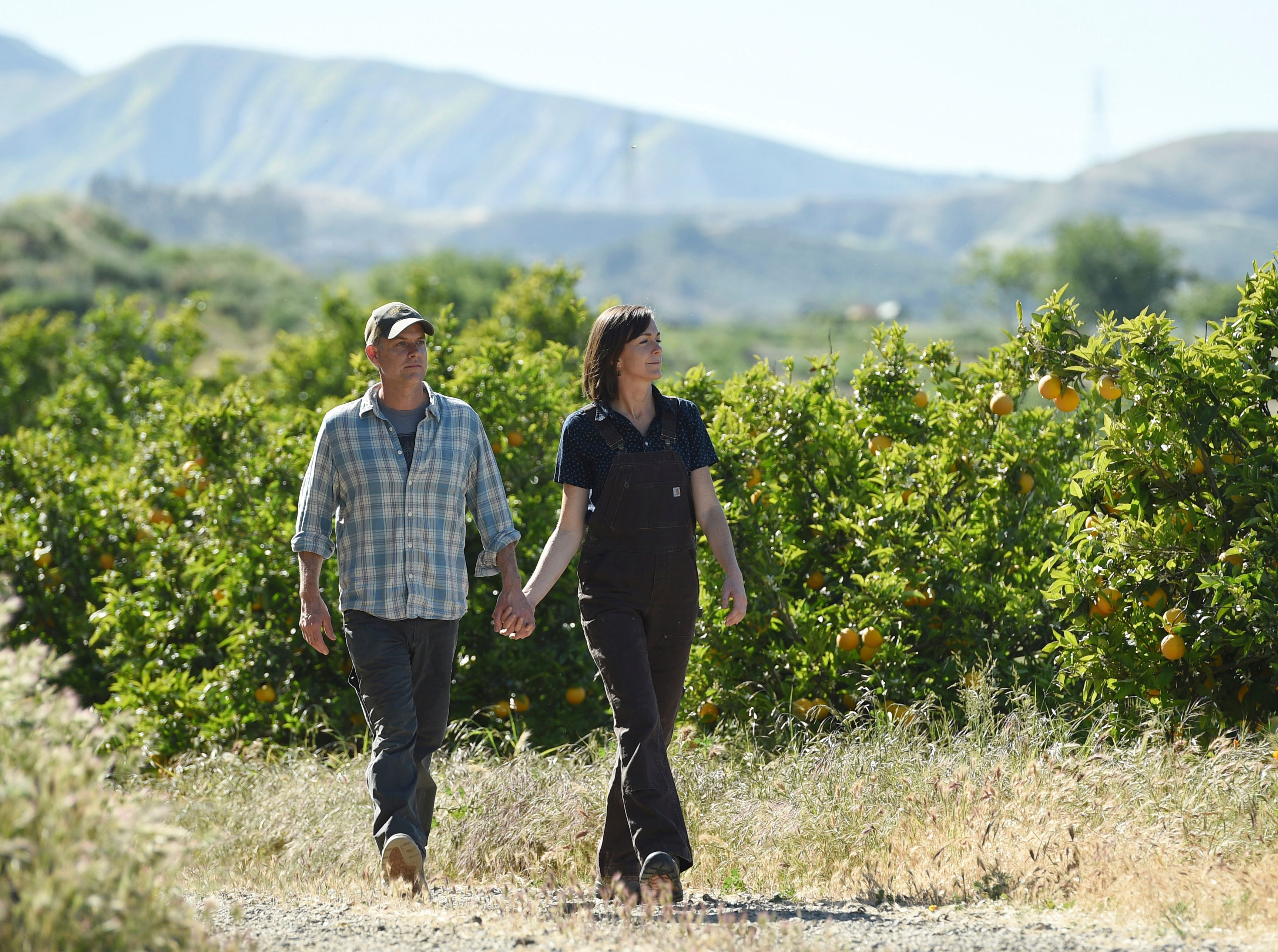 "This April 17 photo shows John and Molly Chester, of the documentary film ""The Biggest Little Farm,"" at Apricot Lane Farms in Moorpark."