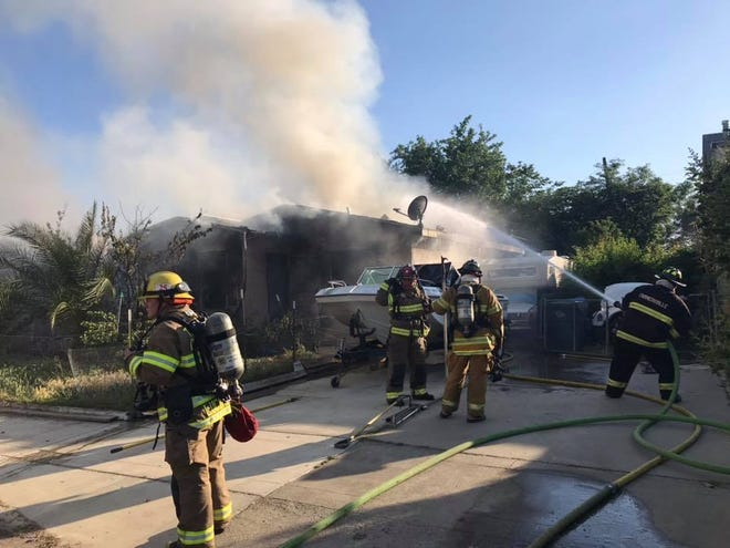 Tulare County firefighters battle a two-alarm fire in Exeter on Saturday, May 11, 2019.