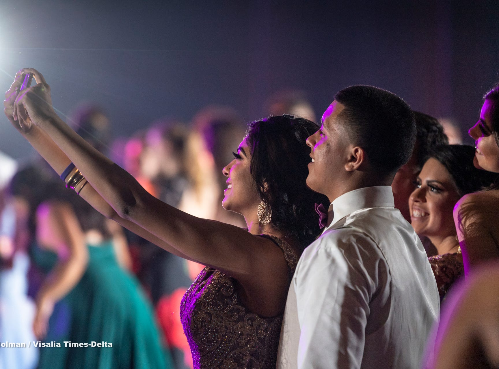 Golden West student Savannah Gutierrez takes a selfie with her date  Emmanuel Lopez during Visalia Unified School District's High School prom on Saturday, May 11, 2019.