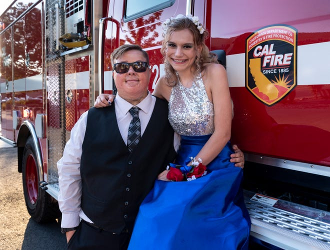Christian Pine, left, and his date Sky Reese were surprised with a ride to prom  in the fire engine during their dinner before Visalia Unified School District's High School prom on Saturday, May 11, 2019.