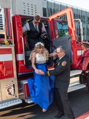 Chief Gratian Bidart helps Sky Reese and Christian Pine down from the fire engine on Saturday, May 11, 2019. Pine and his date were surprised with the ride to prom during their dinner before Visalia Unified School District's High School prom.