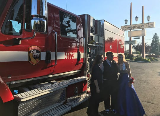 Christain Pine and his date, Sky Reese, were surprised after dinner at the Lamp Liter Inn by a CAL FIRE engine, which drove the couple down Main Street to prom on Saturday.