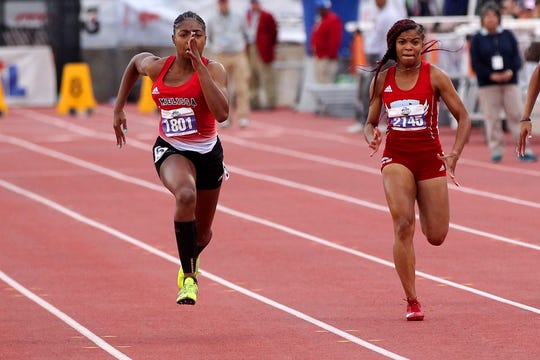 Hirschi's Breonna Campbell (right) takes fourth place in the 4A girls 100 Saturday night.