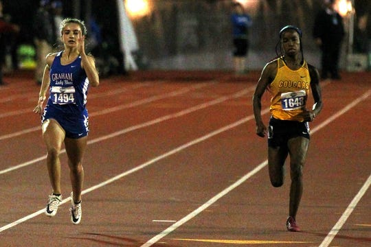 Graham's Summer Croxton (left) finished fourth in the 4A 200 with a 24.90 Saturday night.