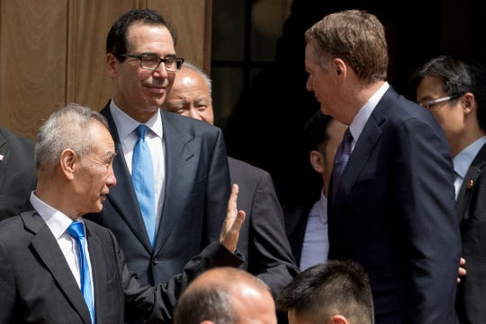 Treasury Secretary Steve Mnuchin, second from left, and United States Trade Representative Robert Lighthizer, right, speak with Chinese Vice Premier Liu He, left, as he departs the Office of the United States Trade Representative in Washington, Friday, May 10, 2019.