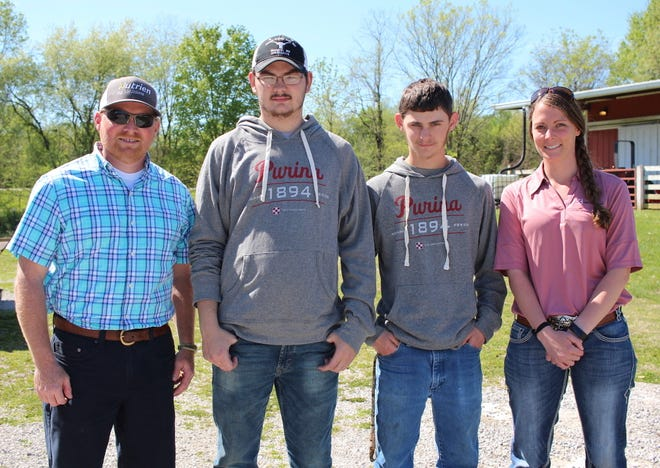 From left, Andy Moore, Barren County High School agriculture teacher; BCHS juniors Donovan London and Daylin Posey; and Katie Carrier, mid-atlantic division livestock production specialist for Purina Animal Nutrition, pose outside of BCHS, April 22, 2019, in Glasgow, Ky. BCHS agriculture students recently helped conduct a 28-day feed trial with Purina Animal Nutrition.