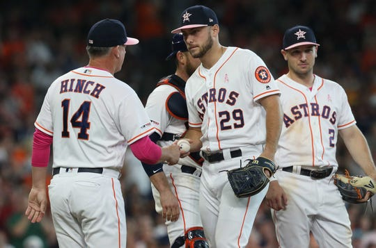 Astros manager A.J. Hinch takes the ball from Corbin Martin in the top of the sixth inning of Martin's major league debut. He allowed two runs in 5 1/3 innings against the Rangers and got the win.