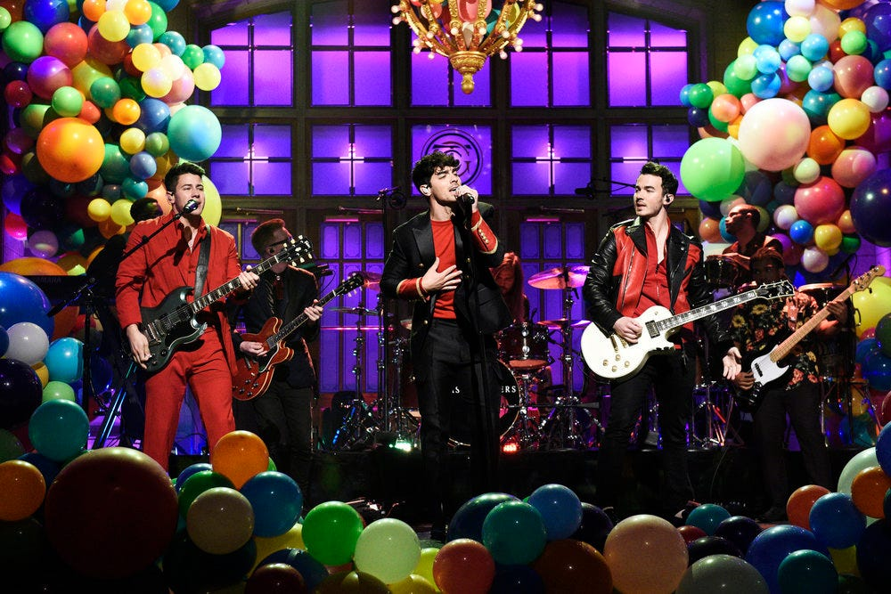 Jonas Brothers go from 'Cool' to 'Burnin' Up' in vibrant 'Saturday Night Live' return