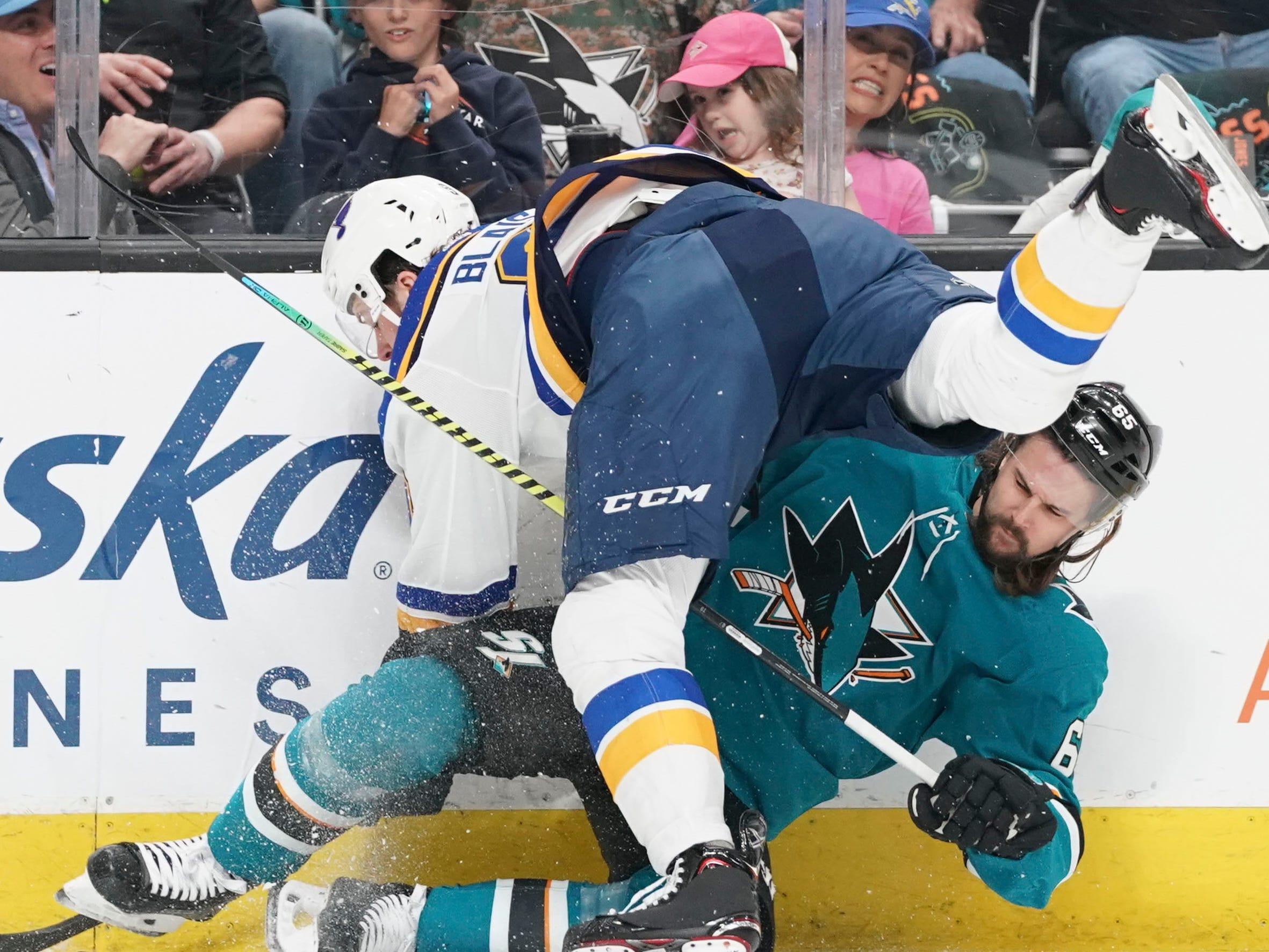 Blues left wing Sammy Blais checks Sharks defenseman Erik Karlsson during Game 1. The Blues plan to play physical hockey against the Sharks star.