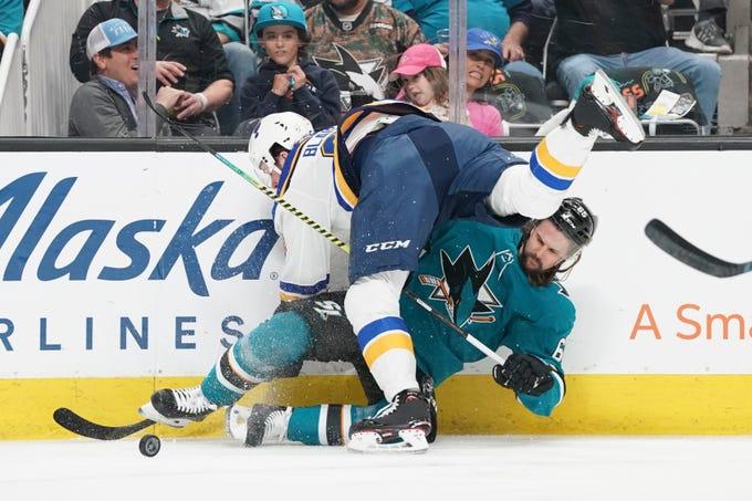 Blues left wing Sammy Blais checks Sharks defenseman Erik Karlsson during Game 1. The Blues plan to play physical hockey against the Sharks star.