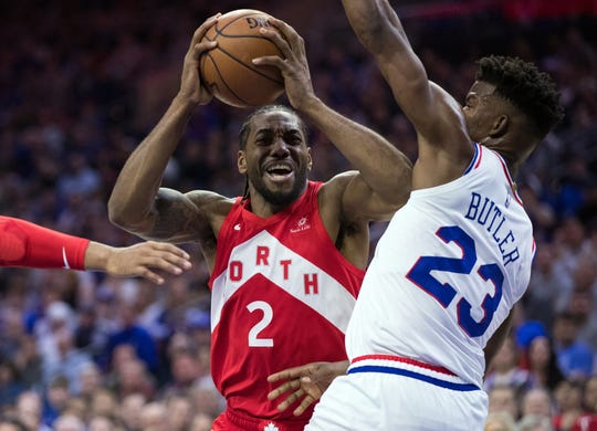 Raptors forward Kawhi Leonard (2) drives as 76ers guard Jimmy Butler (23) defends during Game 6 of their playoff series.