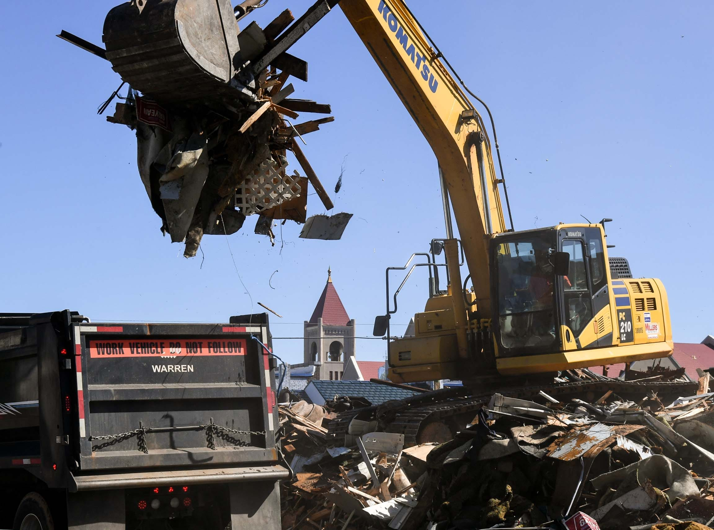 Miller Construction of Anderson load a dump truck with debris in view of city hall during demolition of the 600 South Main Street building Monday in Anderson. The building was used as a city planning and codes for years after McDougalds Funeral Home occupied it from 1934 to 1968 as their South Chapel. Over 150 truck loads of debris is expected to be sent to the Starr landfill, said supervisor Matt Miller at the site.