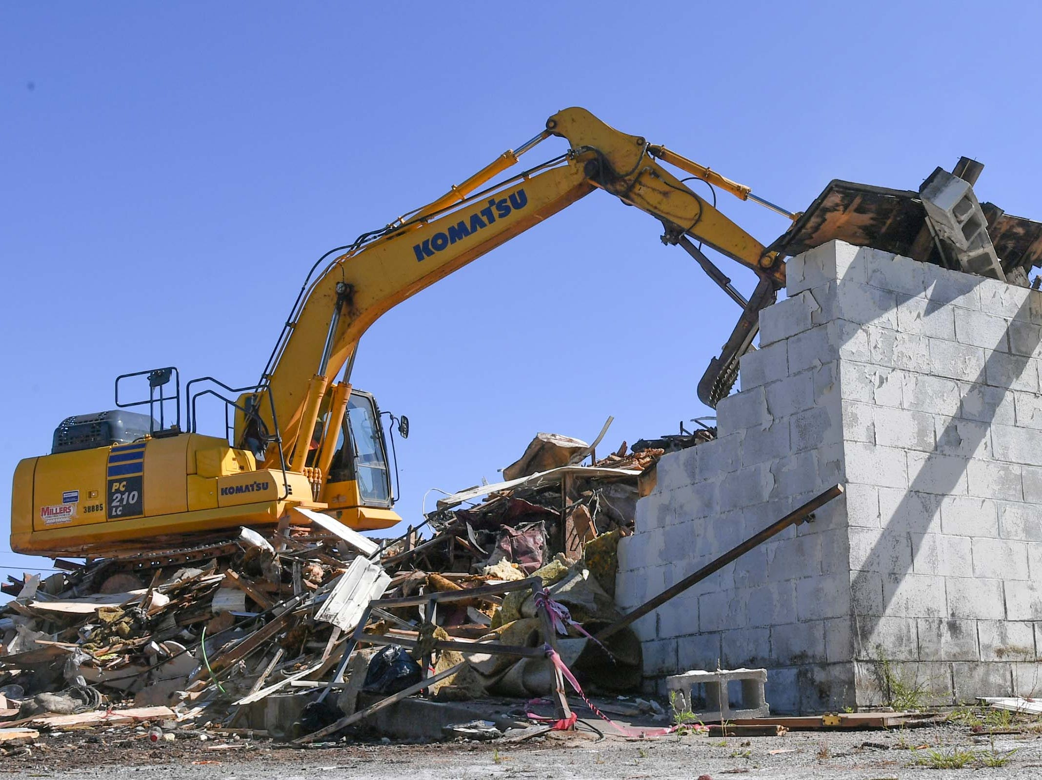 Miller Construction of Anderson demolishes the 600 South Main Street building Monday in Anderson. The building was used as a city planning and codes for years after McDougalds Funeral Home occupied it from 1934 to 1968 as their South Chapel.
