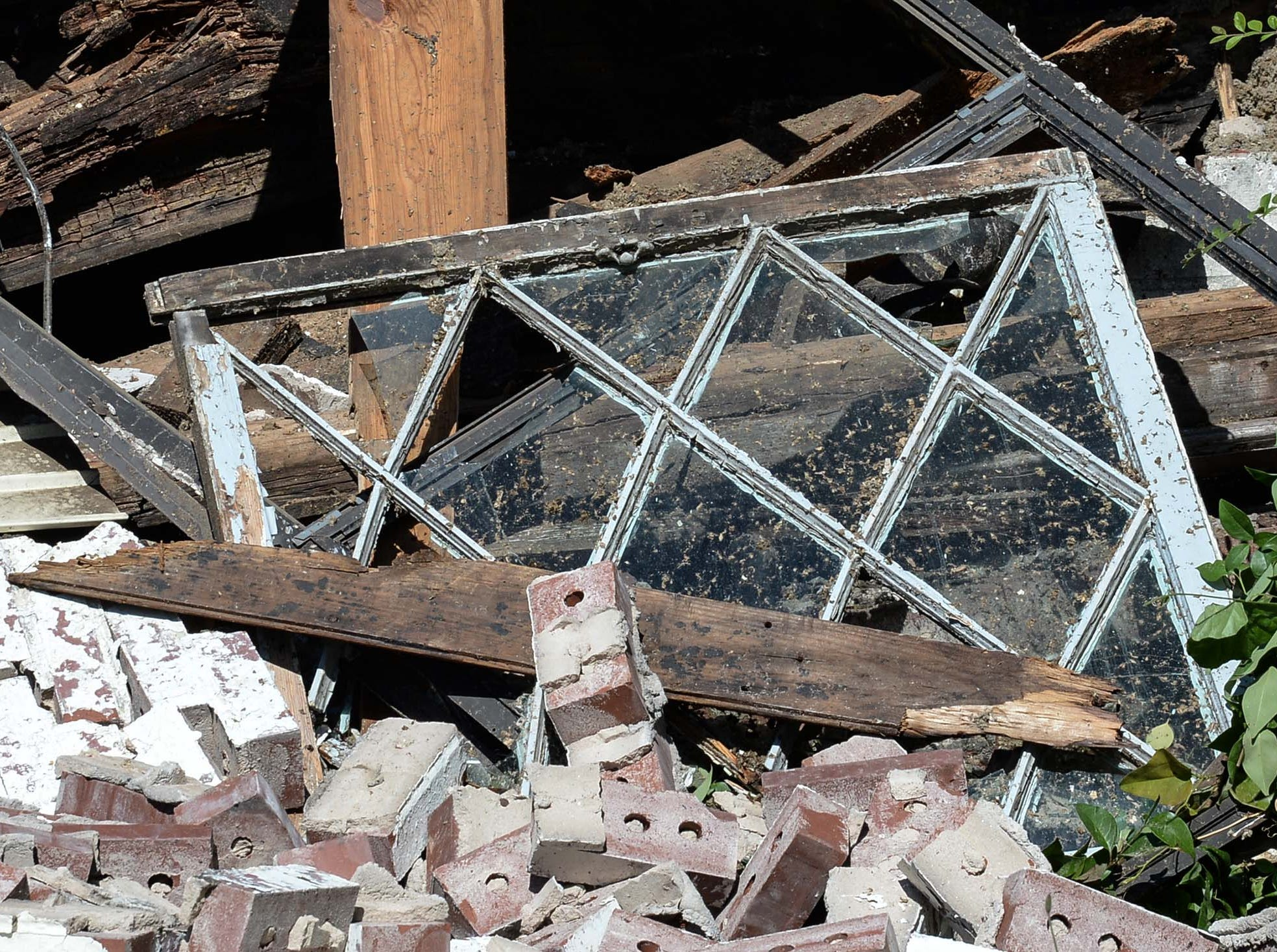 Debris and an old window before being taken to the Starr landfill, after demolition of the 600 South Main Street building Monday in Anderson. The building was used as a city planning and codes for years after McDougalds Funeral Home occupied it from 1934 to 1968 as their South Chapel.