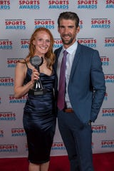 Softball Player of the Year award winner Syd Supple of Oshkosh North with Olympic great Michael Phelps at the 2019 Wisconsin High School Sports Awards. The event was held May 8 at the Fox Cities Performing Arts Center in Appleton.