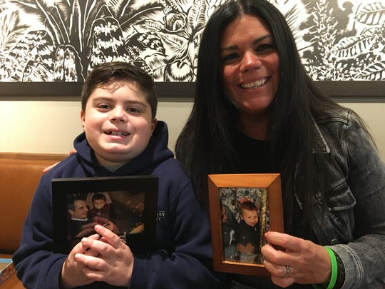 Susan Callari Diamond and son Jake Diamond hold photos of Ben Diamond.