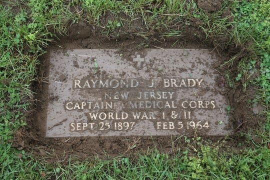 Marine Corps veteran Robert Betz uncovers the footstone of WWI and WWII veteran Raymond J. Brady, one of hundreds of footstones of WWI and WWII soldiers sinking into the ground and disappearing, at Mt. Olivet Cemetery in Middletown, NJ Monday May 13, 2019.