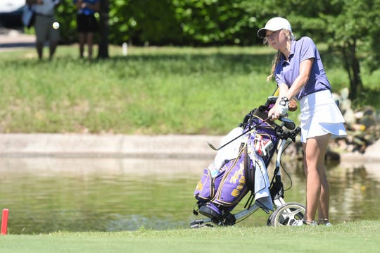 Wylie's Brylee Valentine his a shot on the 18th hole during the first round of the Class 5A state tournament at the White Wing Golf Club in Georgetown on Monday, May 13, 2019. Valentine shot a first-round 92.