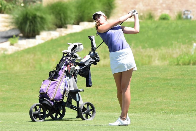 Wylie's Maddi Olson follows through on a shot at the ninth hole during the first round of the Class 5A state tournament at the White Wing Golf Club in Georgetown on Monday. Olson shot a 1-over 73 and is tied for third one shot behind the leaders.