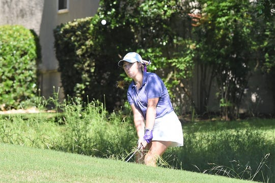 Wylie's Andrea Davis watches her shot during the first round of the Class 5A state tournament at the White Wing Golf Club in Georgetown on Monday. Davis shot a 91 in the first round.