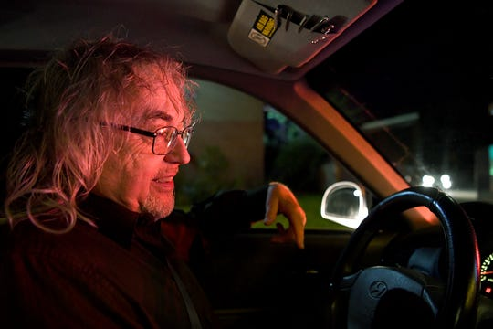 Mike Hiers stops at a red light on his way to pick up an order for Postmates, a food delivery service, on April 25, 2019.