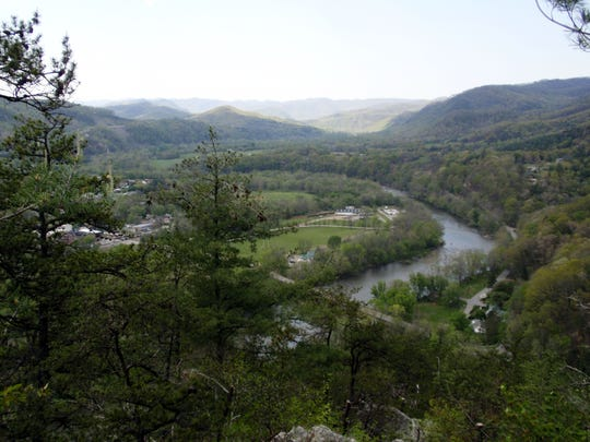 This undated image courtesy of the Appalachian Trail Conservancy shows a view  from Lovers' Leap along the Appalachian Trail in Hot Springs, N.C. The trail runs across  railroad tracks in Hot Springs, over a bridge straddling a wide, inviting-looking stretch of the French Broad River and alongside the river for less than a mile before climbing up more than 1,000 feet to Lovers' Leap Rock and beyond.     (AP Photo/Appalachian Trail Conservancy)