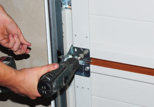 Garage door repair scammers will charge customers three to four times more than a reputable company would charge, and good luck getting them back for a warranty, says Kitsap Garage Door owner John Ramer.
