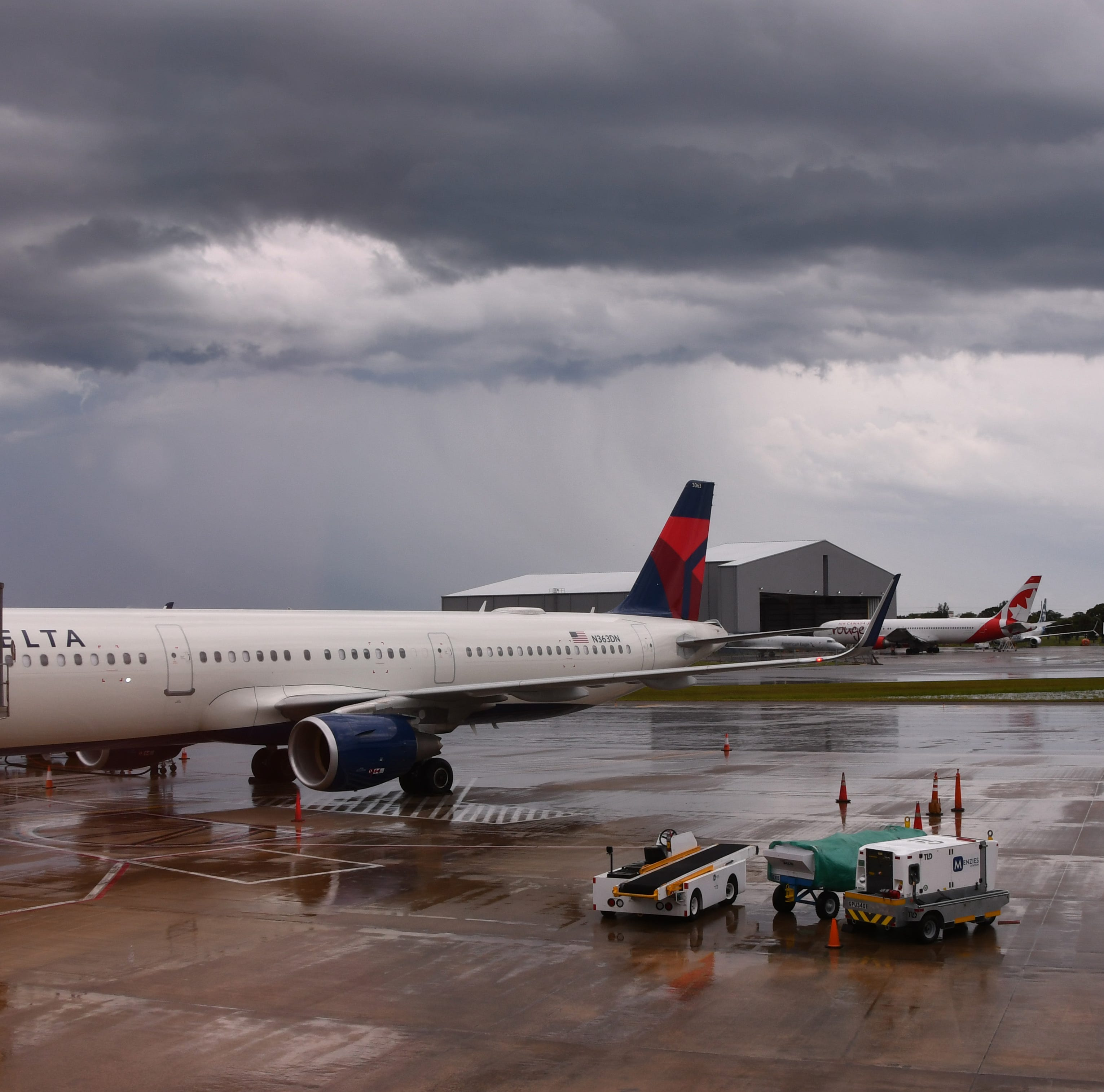 Rough weather forces domestic Airbus flight from New York to divert to Orlando Melbourne International Airport; Over 60 delays reported