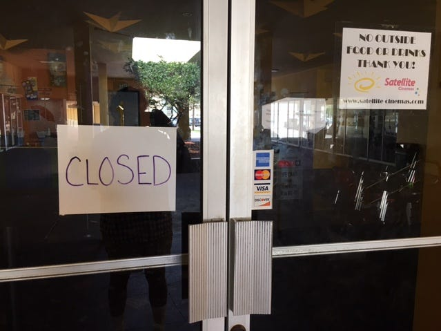 """A """"CLOSED"""" sign greeted guests to the Satellite Cinemas this weekend. Earlier in the week, a """"Closed until further notice"""" sign was on the door."""