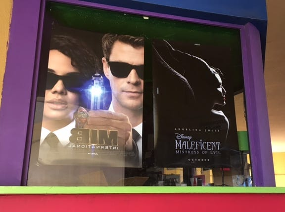 Some posters of movies remained on the outside box office at the Satellite Cinemas.
