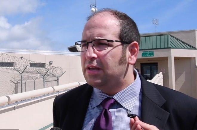 Attorney and Brevard County Commission Vice Chair Bryan Lober talks with reporters outside the Brevard County Jail complex in Sharpes after a court appearance Saturday on behalf of his client, former Palm Bay Deputy  City Manager Dave Isnardi.