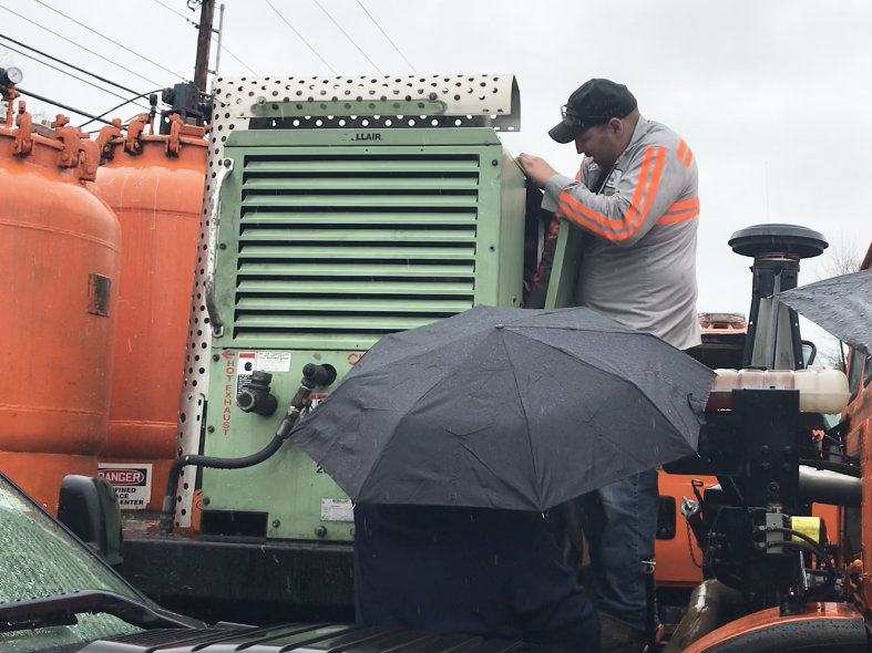 Scott Fleury of Barre examines the interior of a truck-mounted piece of highway stripe-painting gear during a pre-auction tour of surplus equipment in Barre on Friday, May 10, 2019.
