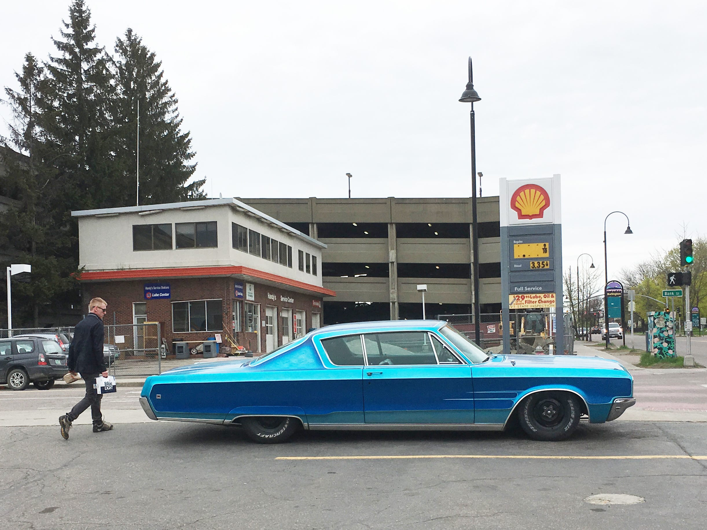 A 1968 Chrysler dominates the parking lot at Simon's Quick Mart in Burlington on Sunday, May 12, 2019.