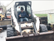 Donnie Smith, who farms in Warren, evaluates a Bobcat loader at a pre-auction display of surplus equipment in Barre on Friday, May 10, 2019.