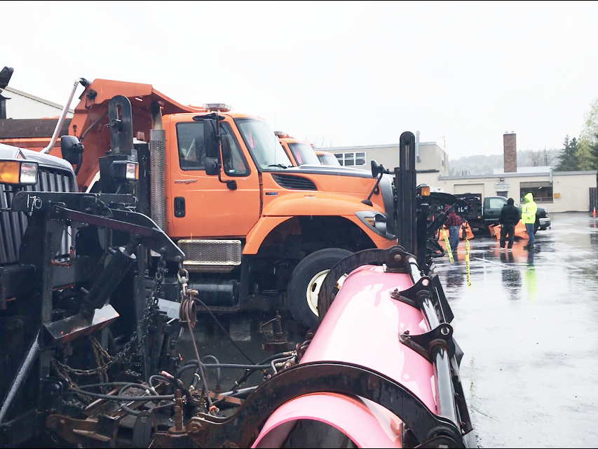 Snow plows and dump trucks line a parking lot at a pre-auction display of surplus equipment in Barre on Friday, May 10, 2019.