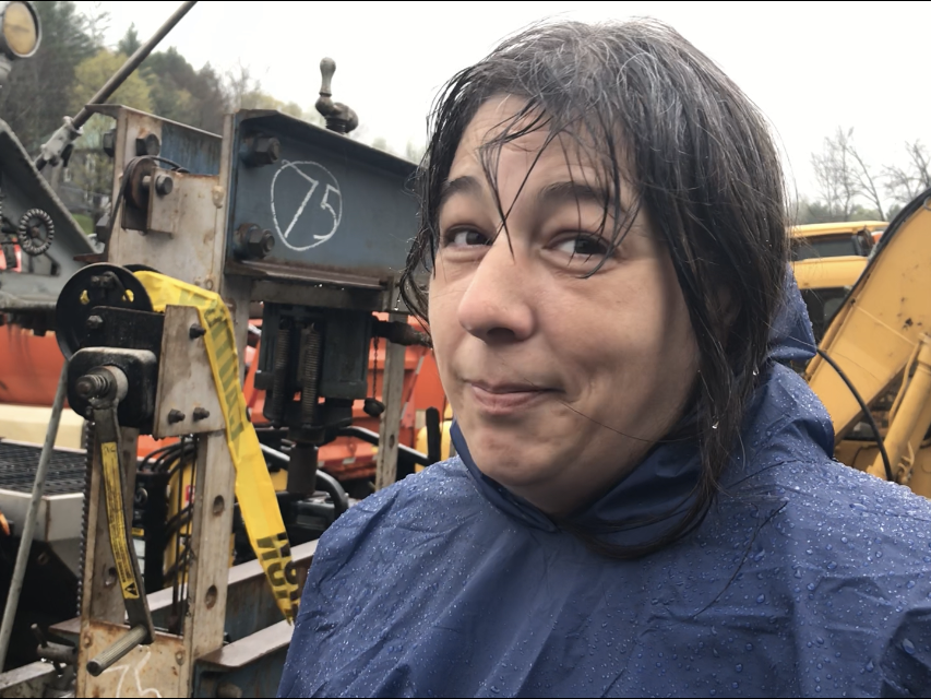 Wet but cheerful: Sarah Grenier, a manager at the Vermont Department of Buildings and General Services, oversees a pre-auction tour of surplus equipment in Barre on Friday, May 10, 2019.