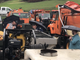Vermonters examine a piece of road-maintenance gear during a pre-auction tour of surplus equipment in Barre on Friday, May 10, 2019.