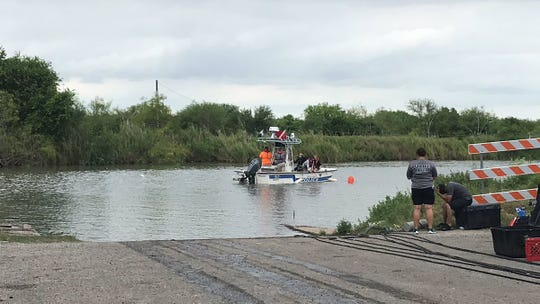 The Corpus Christi Police Department Dive Team works to get a vehicle out of the Nueces River near Labonte Park on Monday, May 13, 2019. The vehicle, believed to be an SUV, went into the water about 12:30 a.m. Monday.