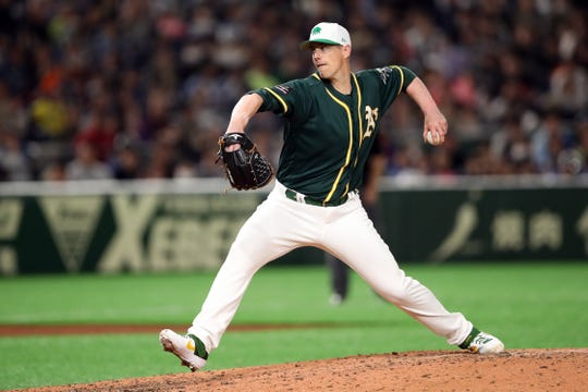 Mar 17, 2019; Tokyo, Japan; Oakland Athletics relief pitcher Ryan Buchter (52) throws a pitch during the fifth inning against the Nippon Ham Fighters at Tokyo Dome. Mandatory Credit: Darren Yamashita-USA TODAY Sports