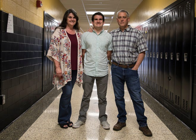 Despite a life of early hardships, Paint Valley's Adrian Salomone's never give up attitude and support of his mom and dad have helped shape Salomone's positive outlook as he continues his education and wrestling career at Wilmington College this fall.  Left to Right: Melissa Salomone, Adrian Salomone, and David Salomone.