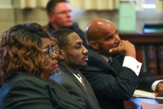 Deonte Baber sits between his attorneys, Bernard Mundy, at right, and Arica Underwood, during opening statements for his trial on Monday May 13, 2019. Baber is standing trial on murder charges in the fatal shooting of Jamie Urton in 2017.
