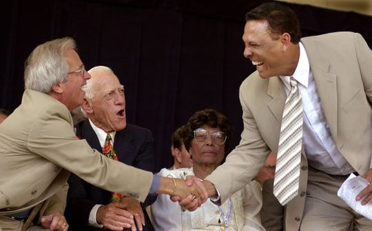 JULY 24, 2000: Tony Perez (right) shakes hands with fellow inductees Marty Brennaman (left) and Sparky Anderson (middle) at the Baseball Hall of Fame induction ceremony in Cooperstown, New York.