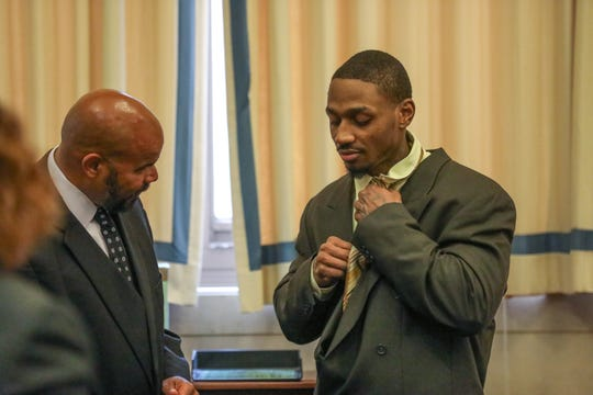Deonte Baber works with his attorney to put his tie on before his trial on Monday May 13, 2019. Baber is accused of shooting and killing Jamie Urton.